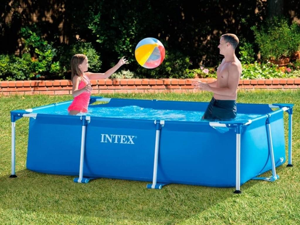 people playing in intex rectangular splash pool