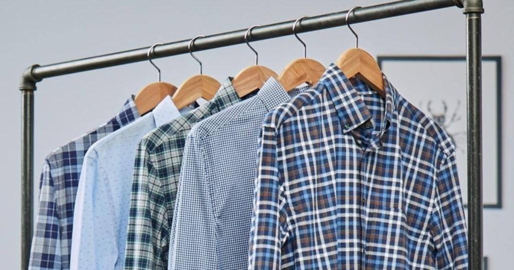 men's dress shirts hanging on a rack
