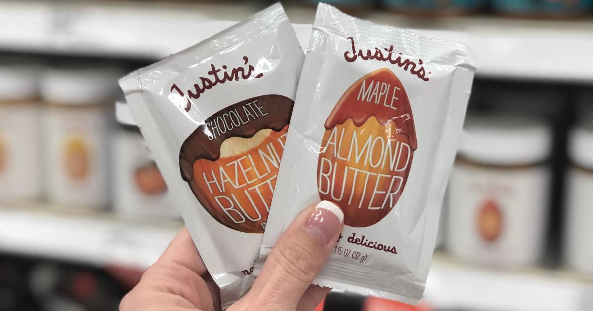 Hand holding Justin's Chocolate Hazelnut & Almond Butter Squeeze