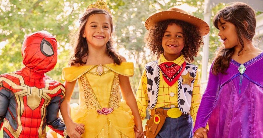 four kids in Disney costumes