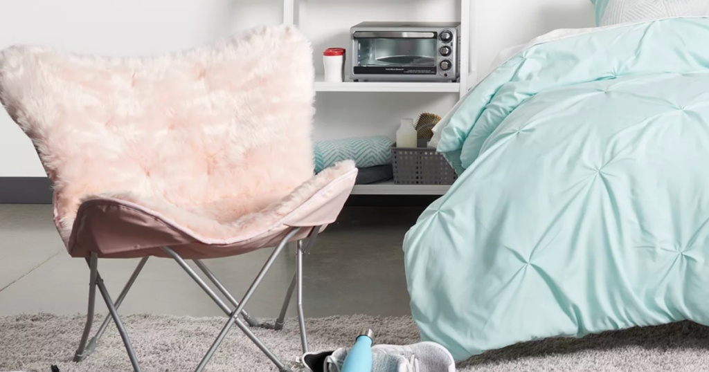 pink butterfly chair in bedroom