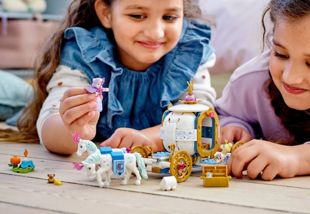 girls playing with LEGO cinderella carriage