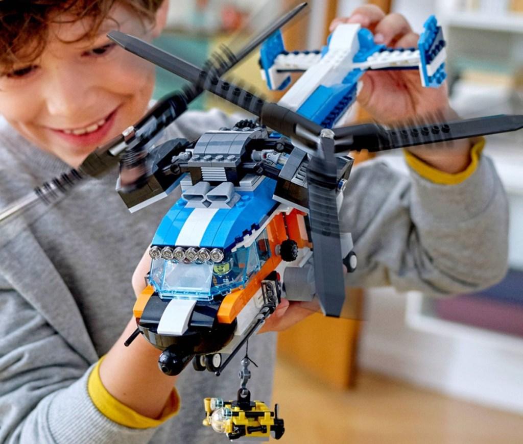 boy holding LEGO creator twin rotor