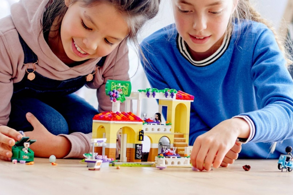 girls playing with LEGO friends restaurant