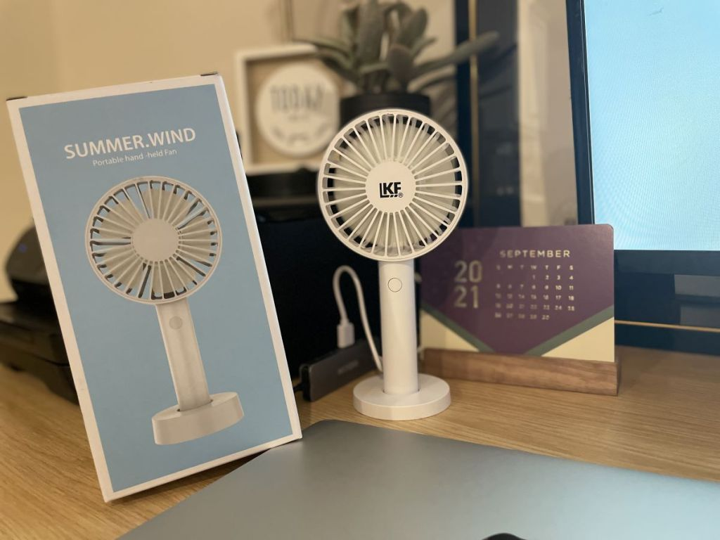 fan sitting on a desk