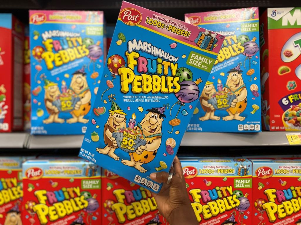 hand holding a box of Marshmallow Fruity Pebbles