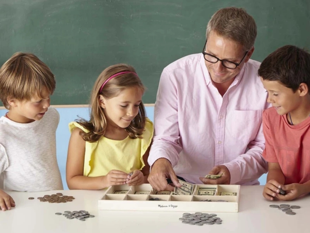teacher and students with melissa and doug play money set