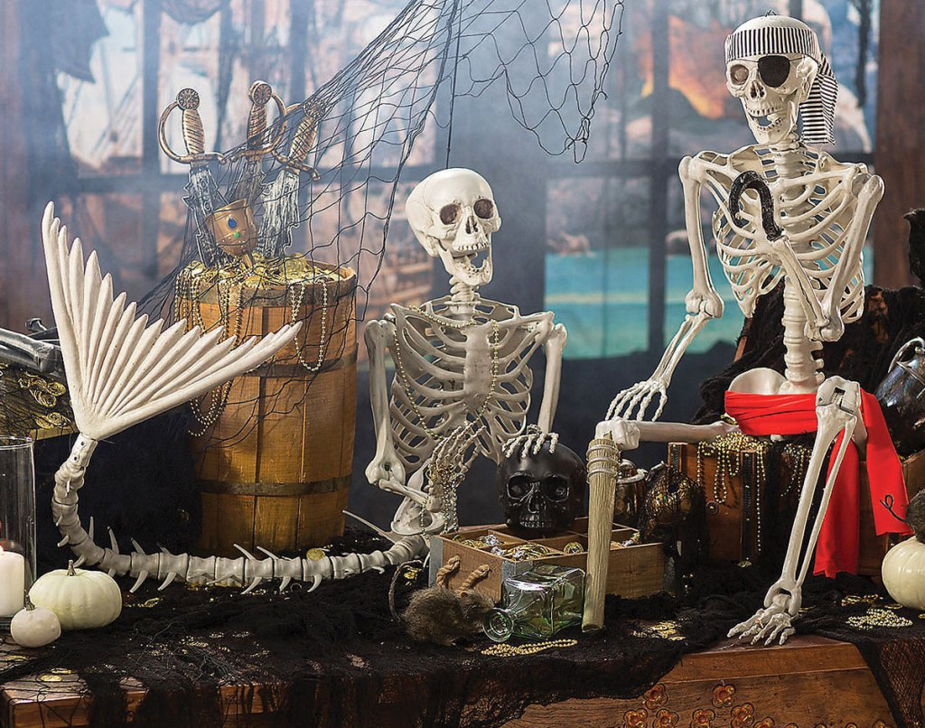 mermaid and pirate skeletons on table