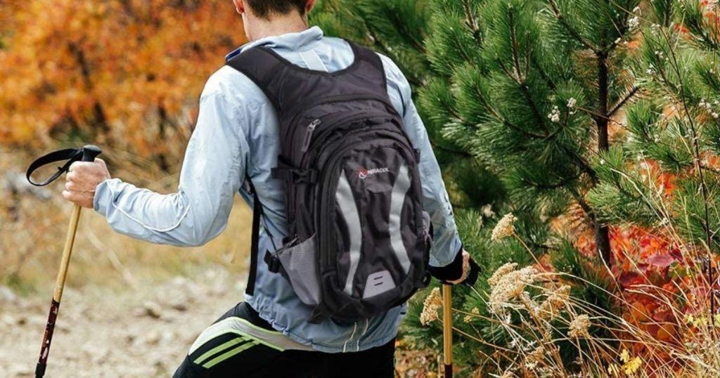 man hiking while wearing a backpack