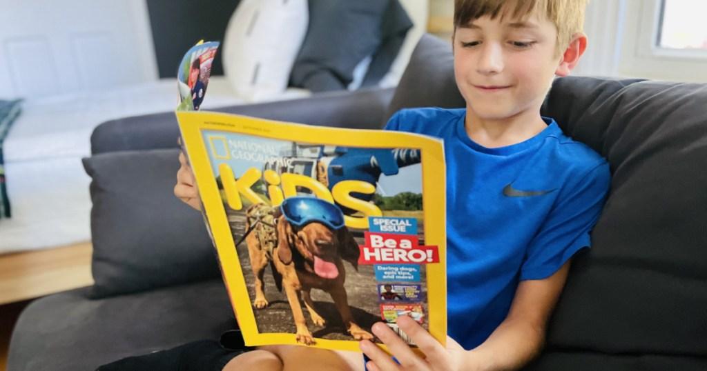 boy reading a national geographic kids magazine