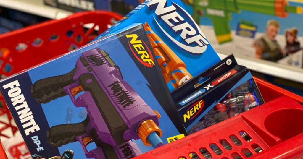 two toy blaster guns in red basket