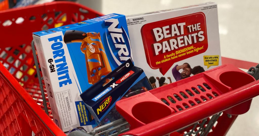 toy gun and board game in red basket