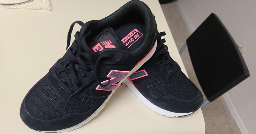 pair of black new balance sneakers