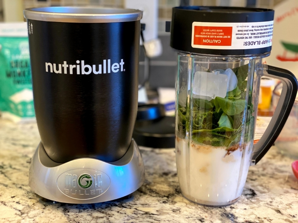 nutribullet rx blender on counter with ingredients in cup
