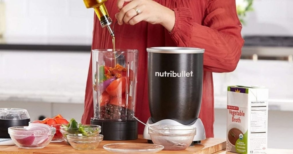 nutribullet rx on counter with person mixing ingredients