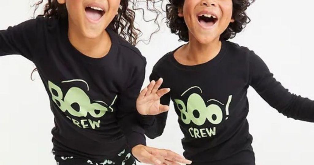 two kids wearing Old Navy Halloween Pajamas
