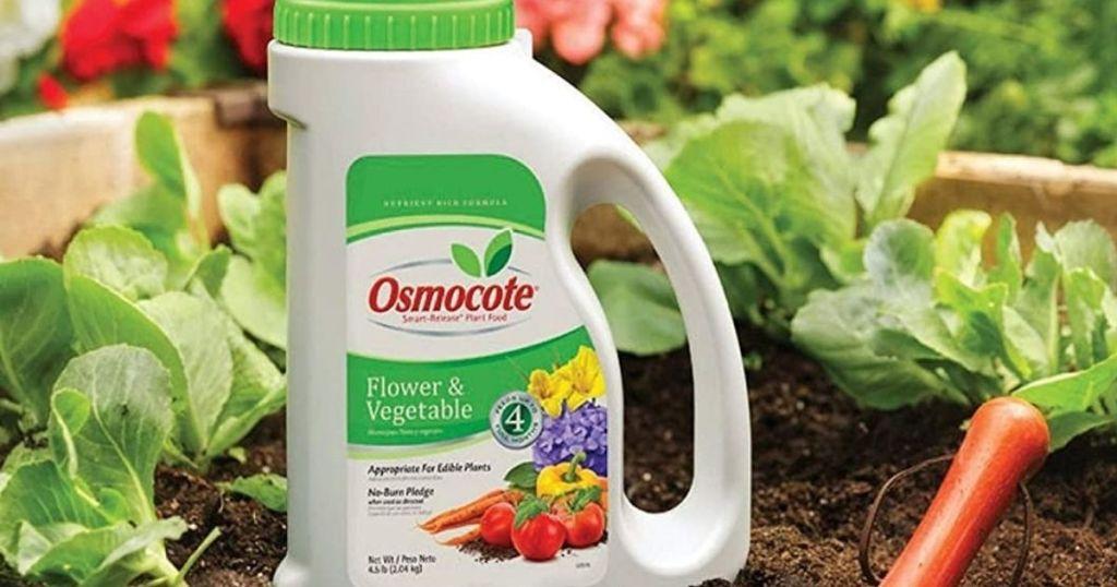 bottle of plant food in a garden