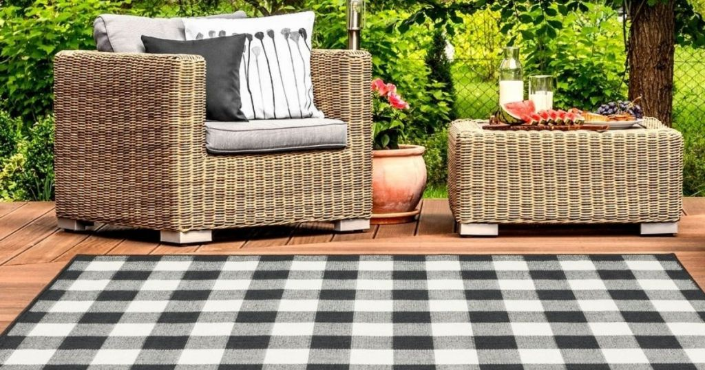 rug in front of patio furniture