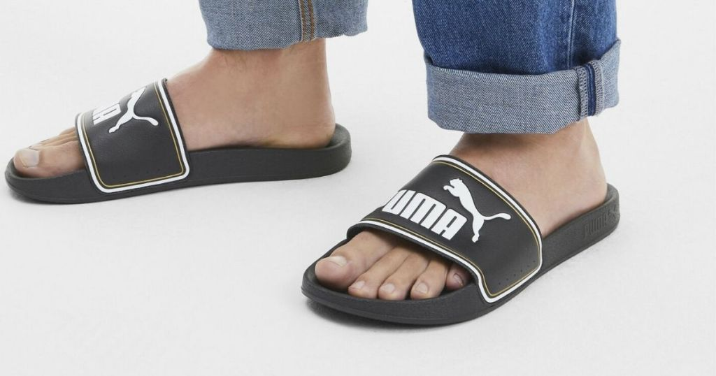 person wearing PUMA sandals