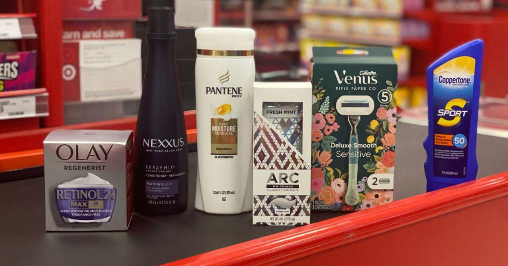 shampoo, sunblock, moisturizer, and razors on conveyor belt