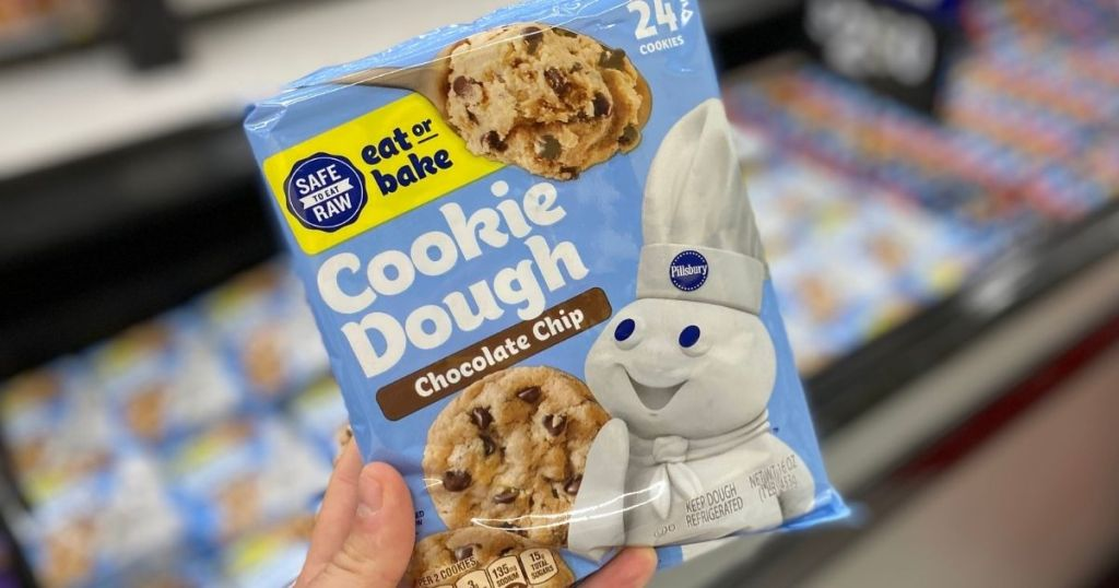 hand holding a package of Pillsbury cookie dough
