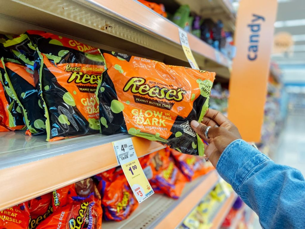 hand holding a bag of Reese's Glow in the Dark peanut butter cups