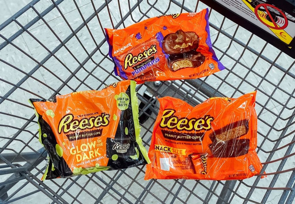 three bags of Reese's candy in a cart