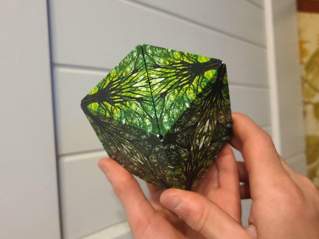 holding a fidget cube