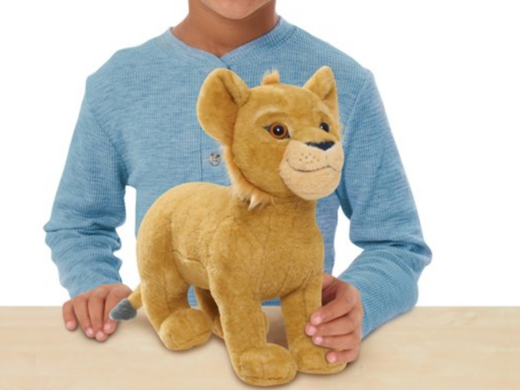 boy with simba plush toy the lion king