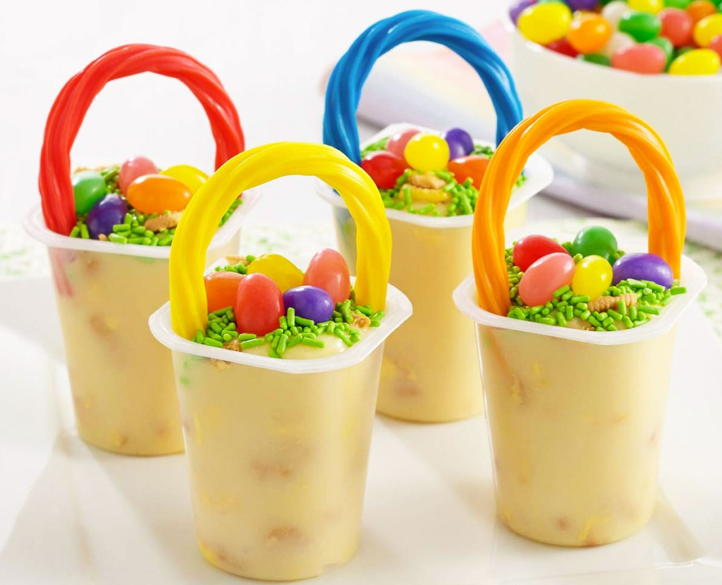 lemon pudding cups decorated with rainbows and jelly beans