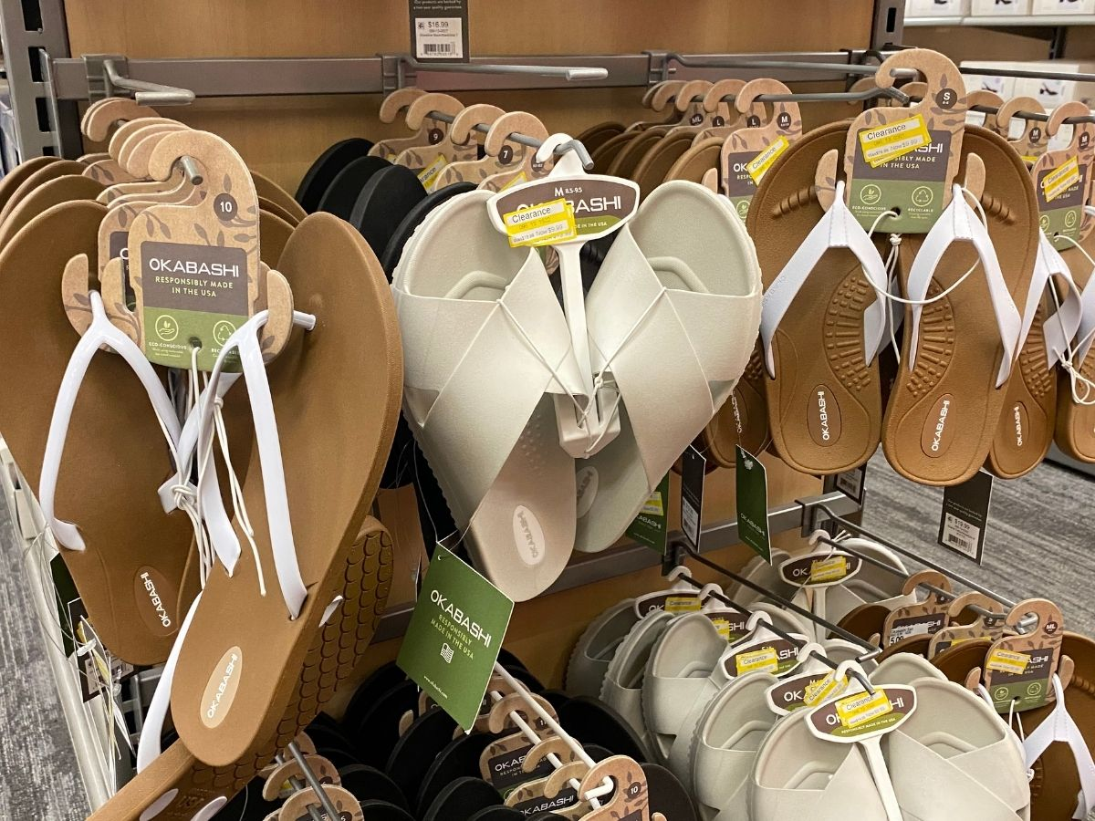 criss-cross white women's sandals hanging in store