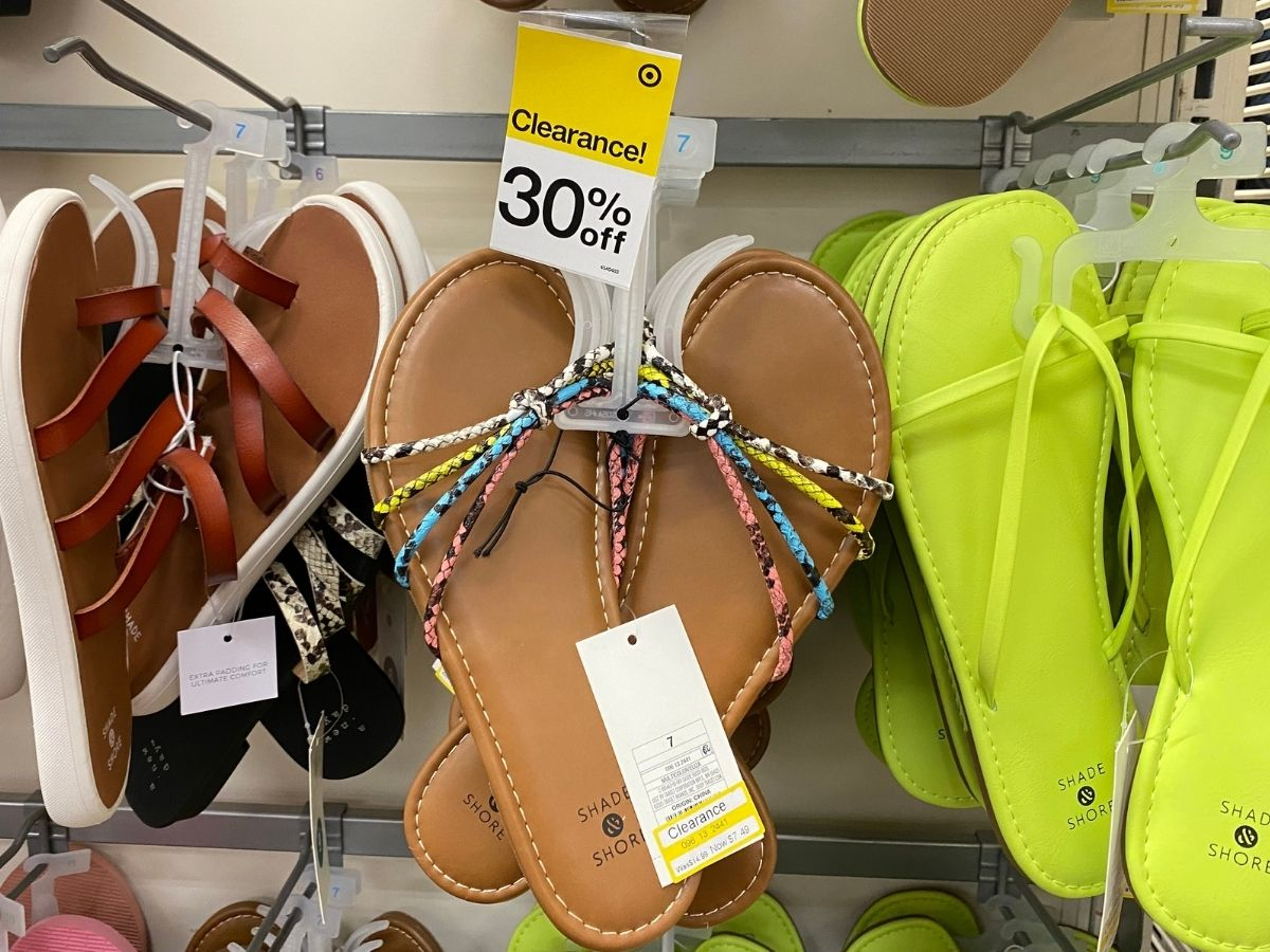 womens colorful strappy sandals hanging in store
