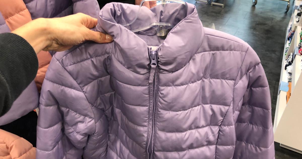 hand holding up a kids puffer jacket