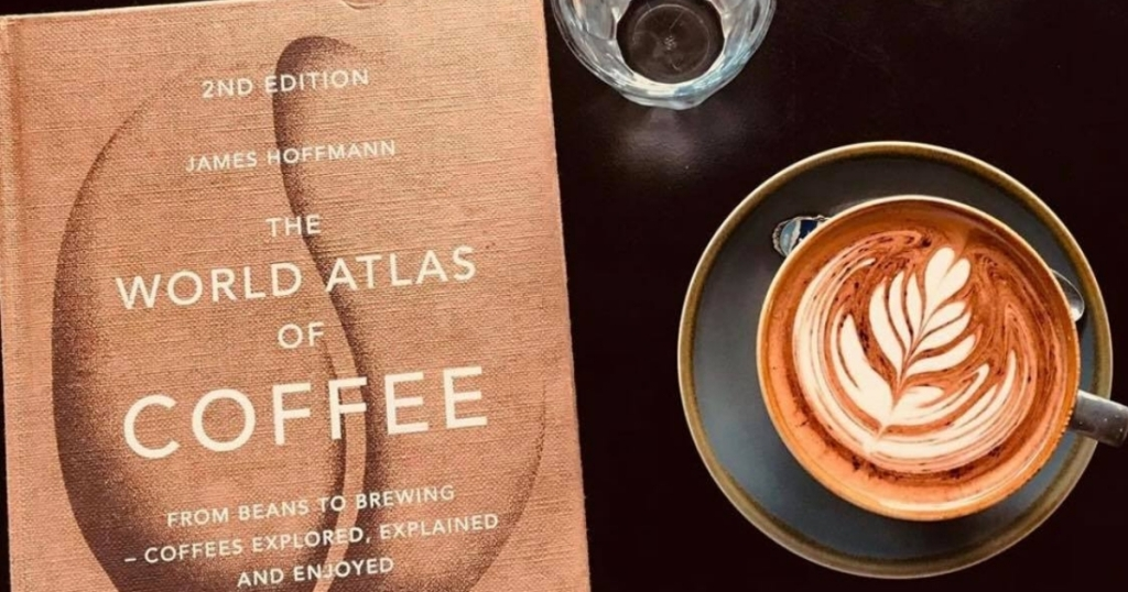 the world atlas of coffee book with cup of coffee