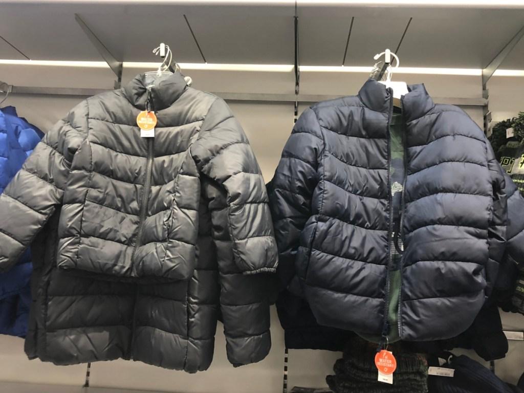 2 children's puffer jackets
