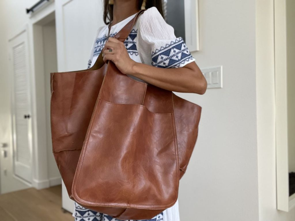 woman carrying a large tote bag