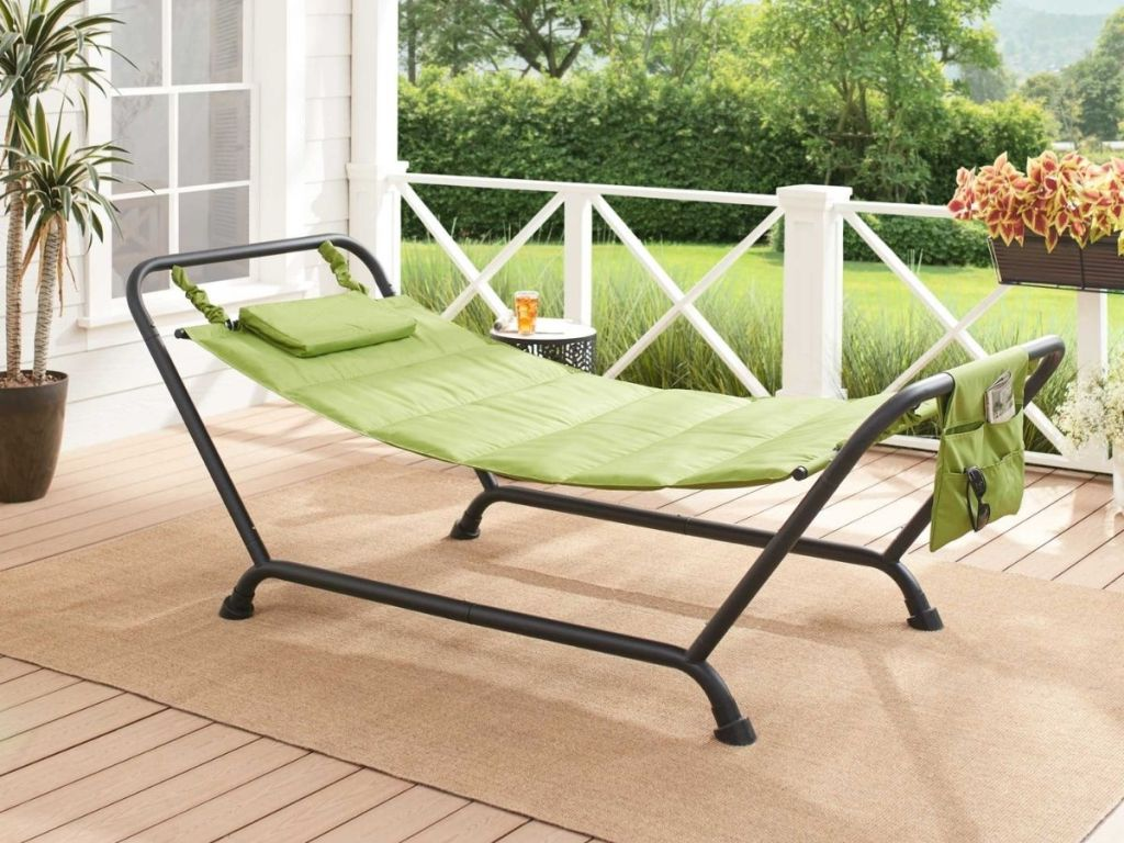 green hammock on stand on porch