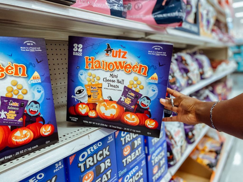 hand holding a box of Utz Halloween Cheese Balls