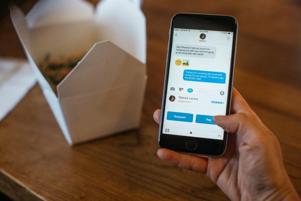 Venmo app on phone in hand