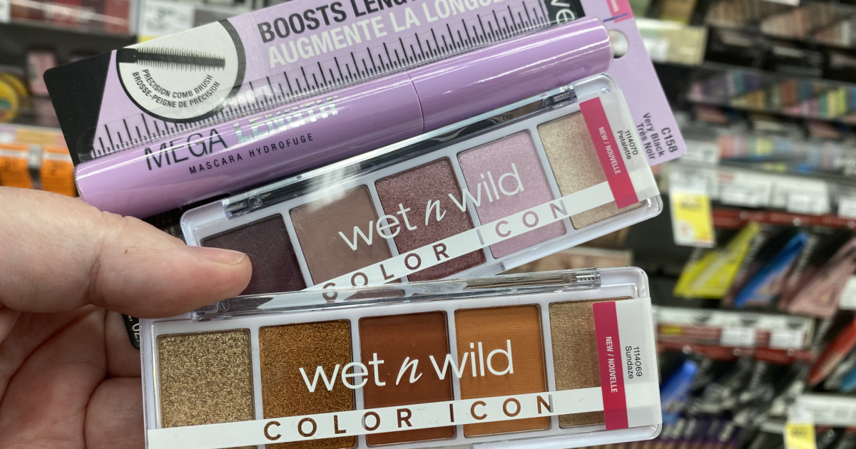 hand holding Wet n wild cosmetics