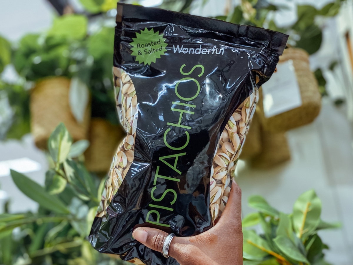 hand holding a 16oz bag of wonderful pistachios