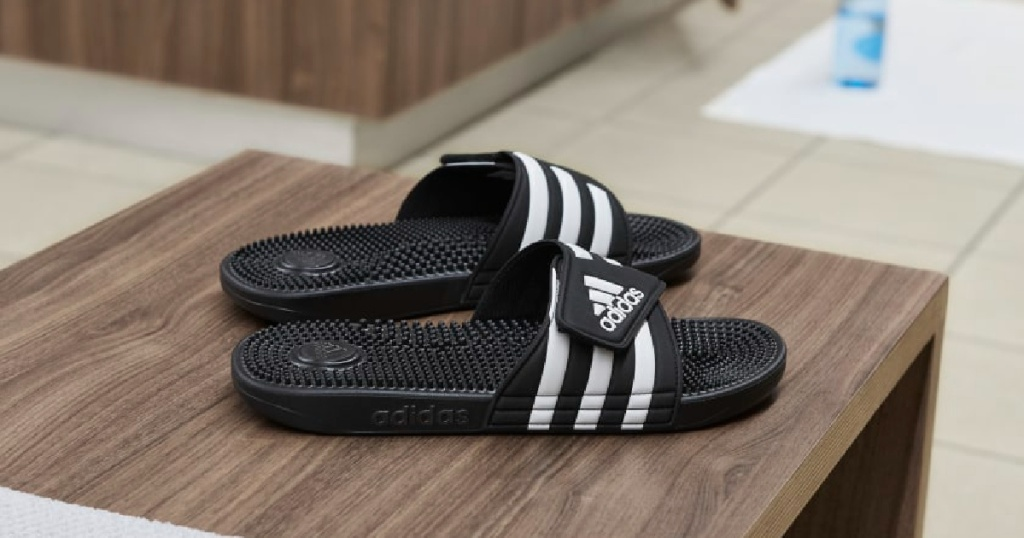 black and white sandles on table