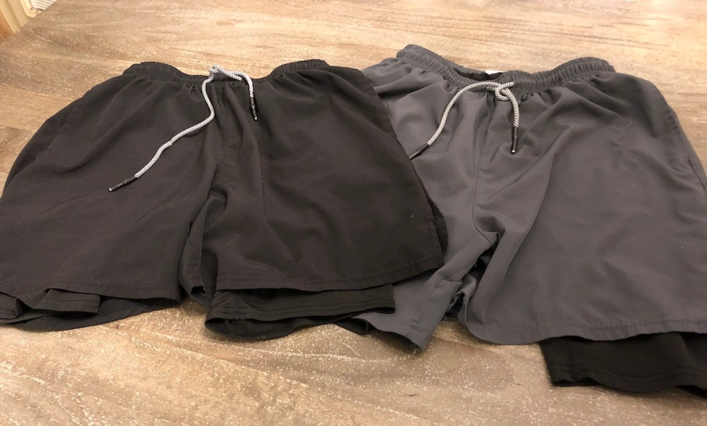 pair of black and gray shorts laying on wood surface