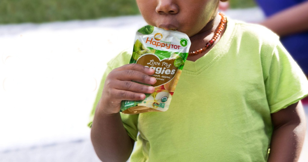 boy eating happy tot food pouch