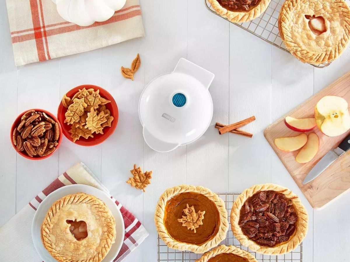 white mini pie maker with mini pies surrounding it