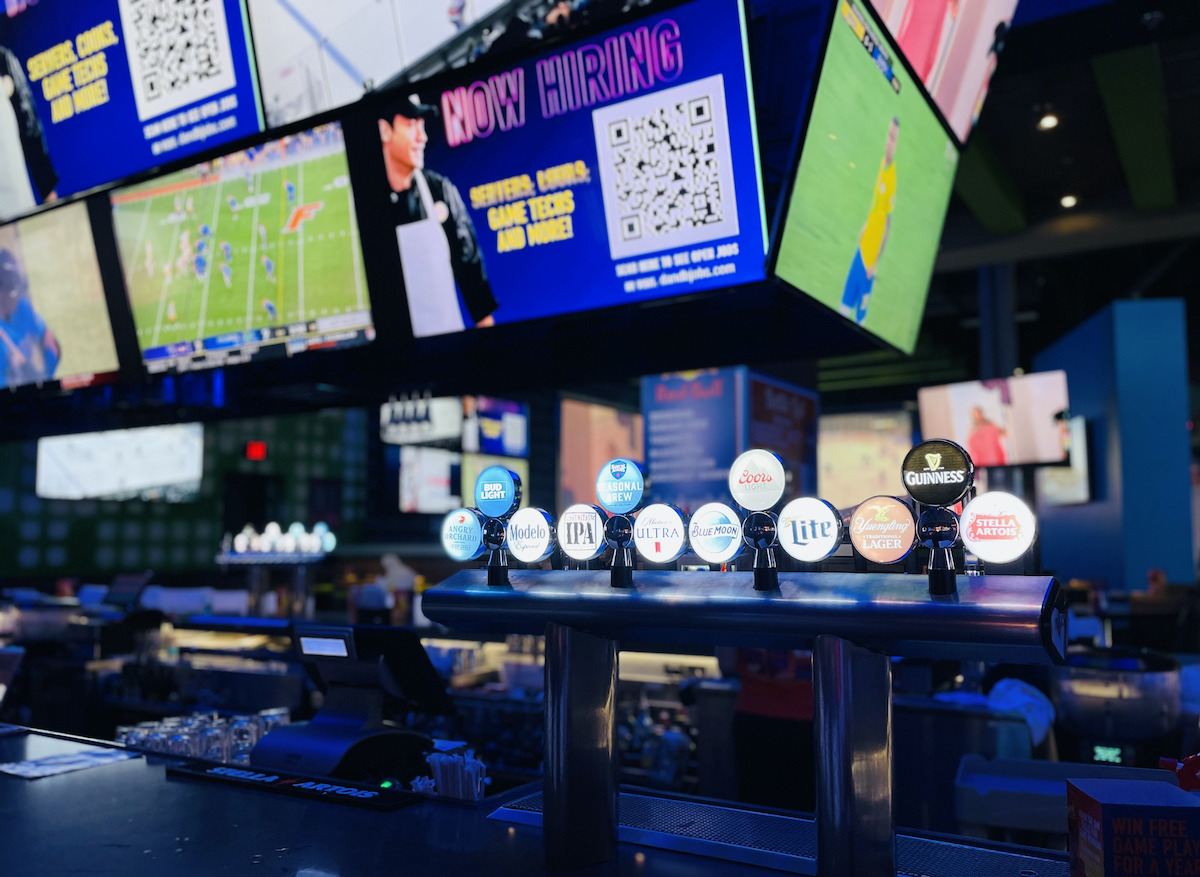 dave and busters sports bar with multiple tvs with games