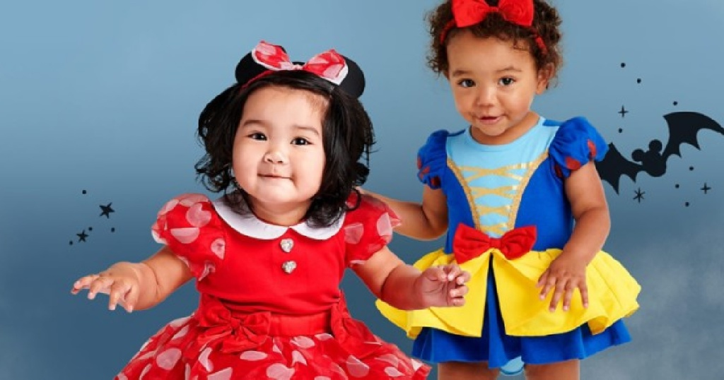 two girls in minnie mouse and snow white costumes