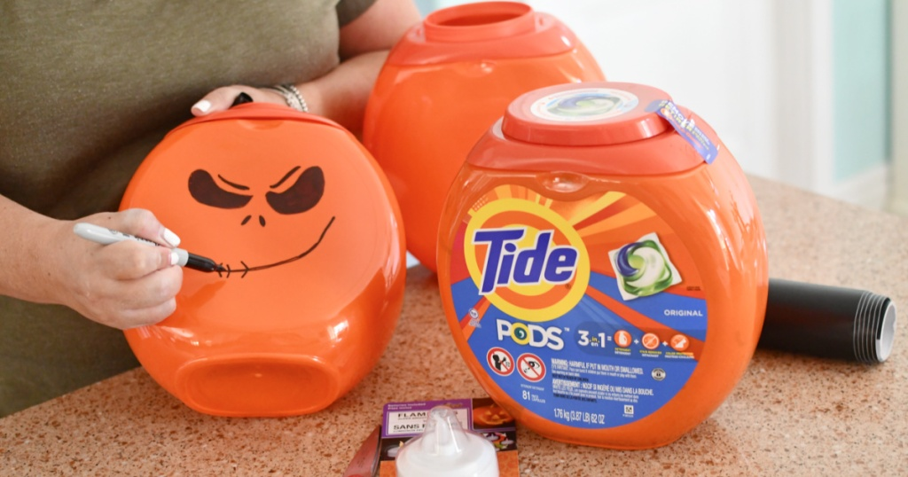 drawing pumpkin face on tide pod container
