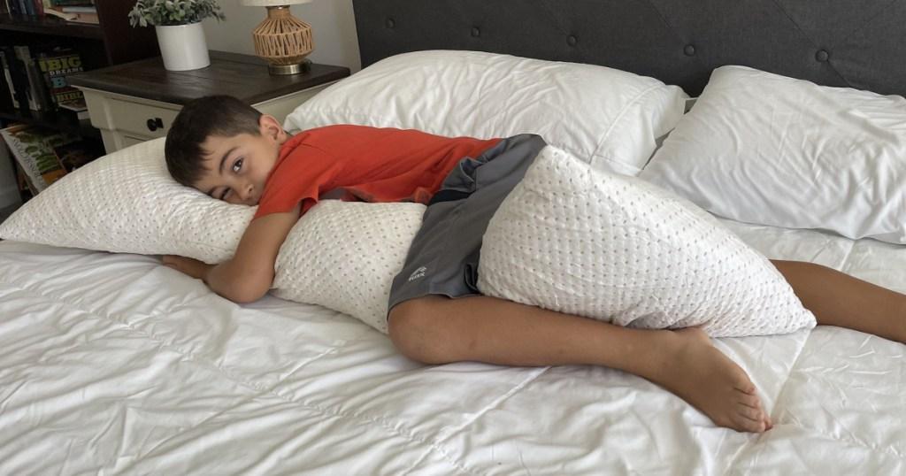 boy laying on elemuse body pillow