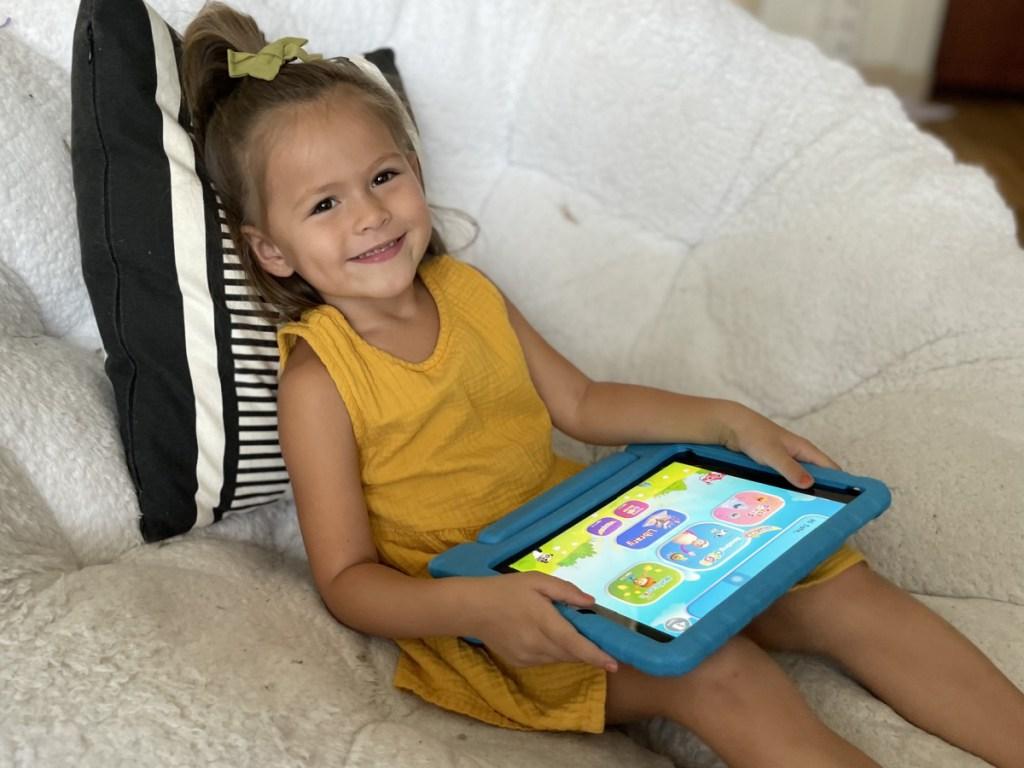 girl playing reading eggs on ipad